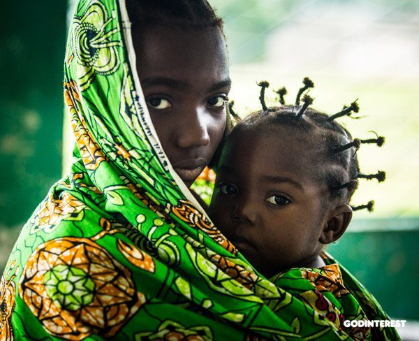 This young girl from the Democratic Republic of Congo brought her younger sister to a health center to have a malnutrition screening, after being driven from their home and community during a violent conflict between the government and anti-government militia. Photo by Vincent Tremeau, UNICEF