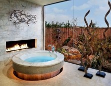 Astonishing and cozy bathrooms design ideas with fireplace 18