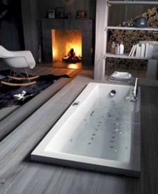 Astonishing and cozy bathrooms design ideas with fireplace 31