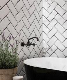 Elegant black herringbone tiles for your space 01