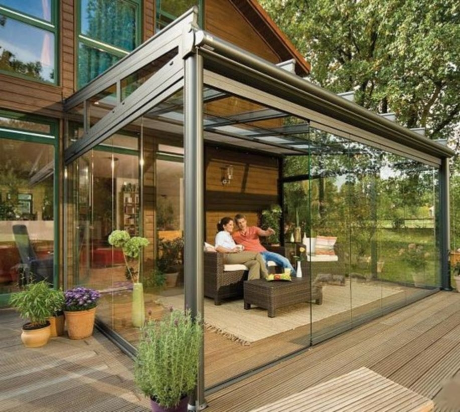 Glass patio rooms in front yard