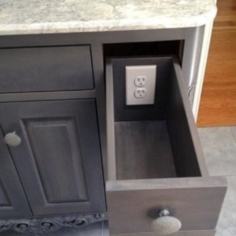 Outlets in drawers mean that you can get all that gadget clutter off the counte