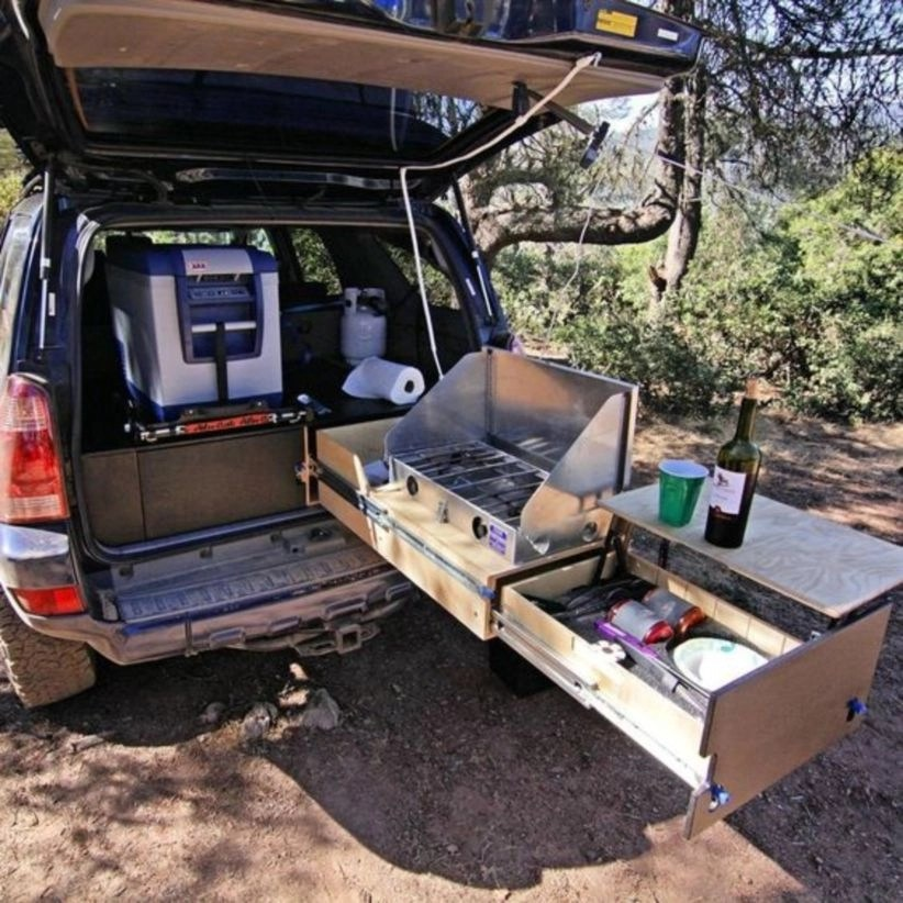 Suv Camper Has A Bed Frame With An Abundance Of Storage Underneath, A  Kitchen Unit