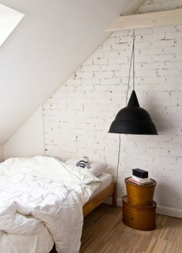Vintage attic bedroom with wall of skylights01