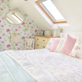 Vintage attic bedroom with wall of skylights15