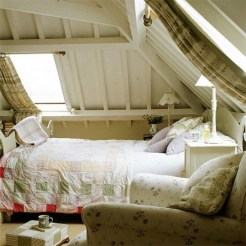 Vintage attic bedroom with wall of skylights40