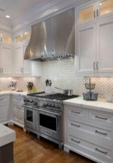 Adorable marble herringbone backsplash detail 21