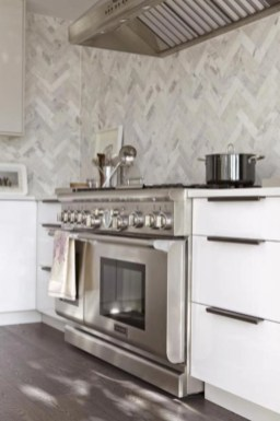 Adorable marble herringbone backsplash detail 24
