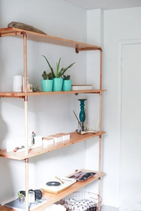 Stunning ideas to use copper pipes for your home decor 34