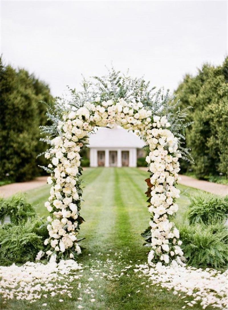 Elegant white rose ceremony arch