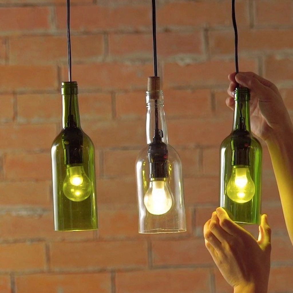 Repurpose a wine bottle into a hanging light Unexpectedly Aesthetic DIY Wine Bottle Crafts That Magically Shining