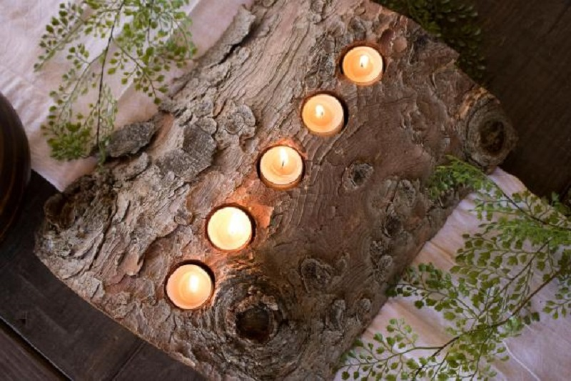 Rustic centerpiece with tea light from a wooden log 4