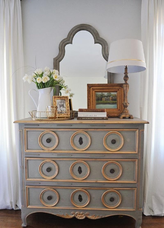 Vintage dresser with ornate mirror