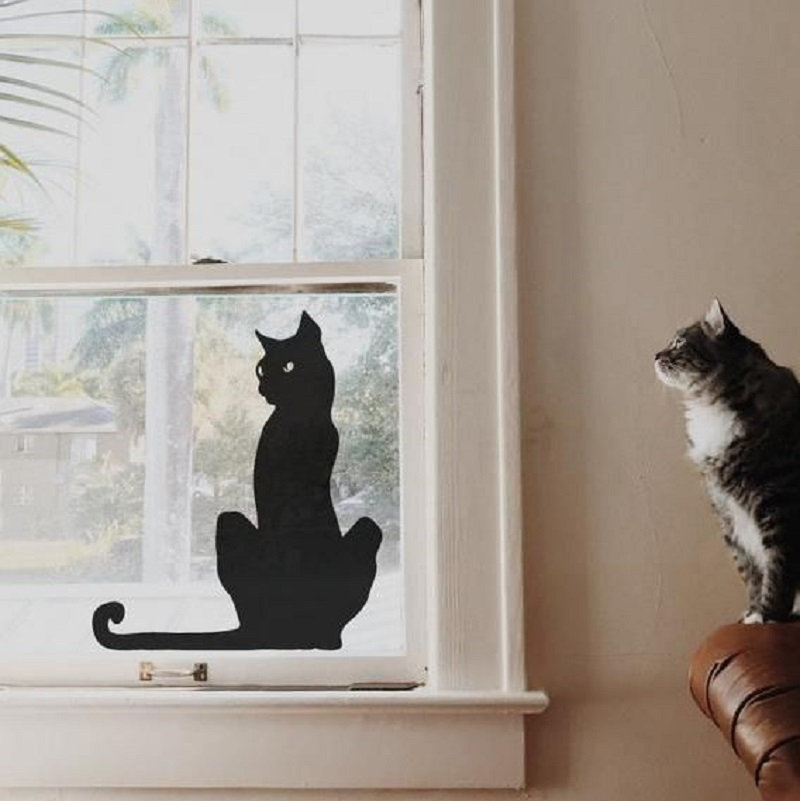 Window decoration with black cat