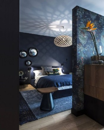 Dark and moody bedroom with navy