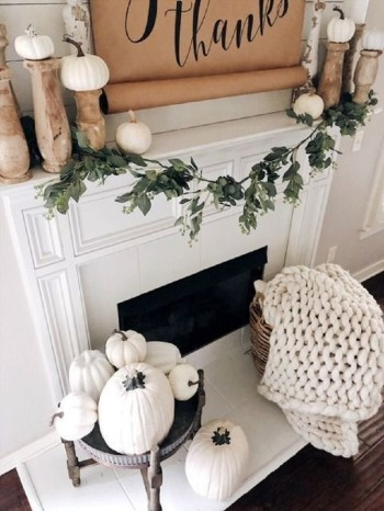Neutral rustic fall decor with a sign