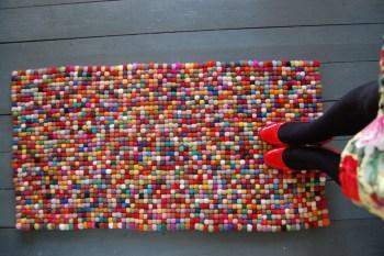 Colorful pom pom rug