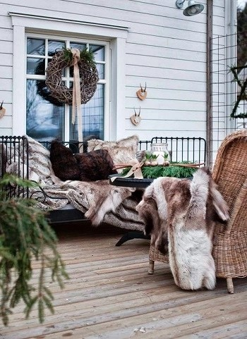 Cozy winter terrace with metal bench Enjoyable Terrace Décor Ideas To Create This Winter To Stay Comfortable