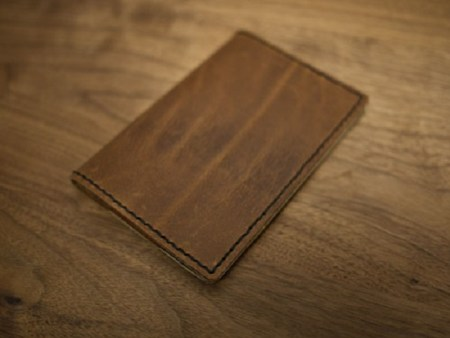 Leather passport holder with wax thread
