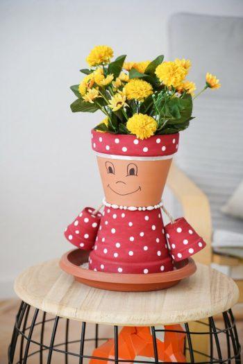 Upcycled flower pot little girl