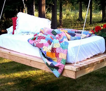 Swinging daybed DIY Outdoor Bed Projects You Can Do For Relaxing Time