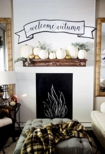 Improve mantel decor with pumpkins