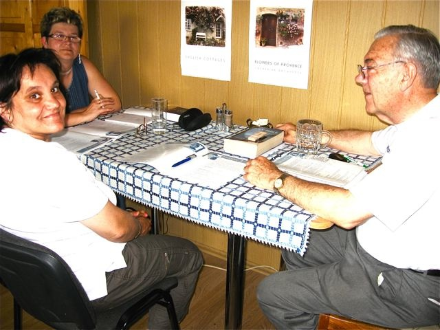 Eniko, Red Cross Office Mgr, Ildiko, Village School Teacher & Dan read in our apartment