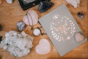 pink crystals near a notebook
