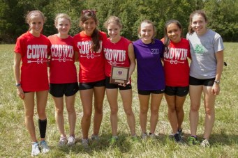 (from l to r) Junior Sarah Goodrich and seniors Katharine Benfer, Marin Bader, Megan Wight, Beth Henshaw, Julianna Keeling, and Hannah Bullen with their first place plaque