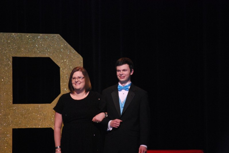 Senior Chris Wooten escorting science teacher Dana Delano.