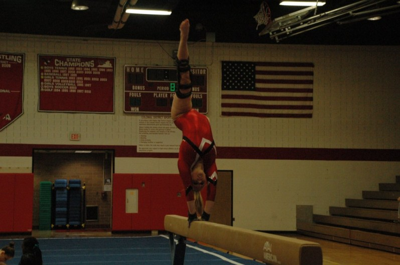 Senior Kelly Price performing her beam routine.