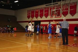 Jessica Martin throws a basket