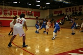 Megan Sherman dribbles down the court