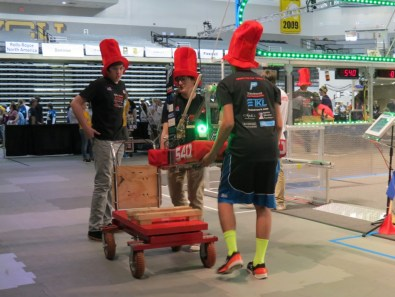 Members of the team loading the robot