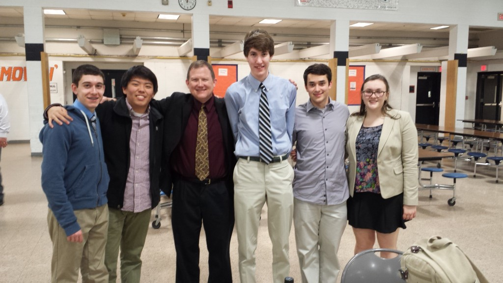 Godwin debate team with sponsor, Dr. Compton