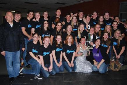 Debut and their choreographer Kristin Mancini with their first place, best choreography, and best vocals trophies