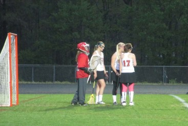 Girls lacrosse getting ready to play