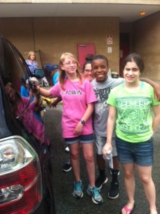 Laura Rauppius, Madison Beale, Noah Lowry, and Sarah Platea (l to r) smile at the car wash.