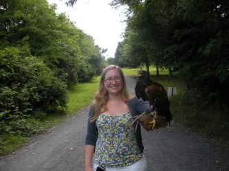 Maley holding a falcon at Bunratty Castle.