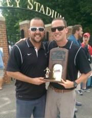 Boys soccer coaches proud to show off the trophies.