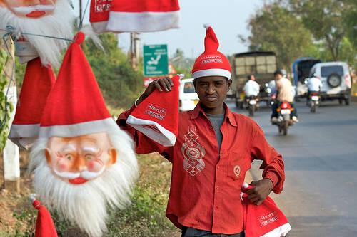 a vendor sells christmas hats in india photo by wwwflickrcom user mr jon ardern esq