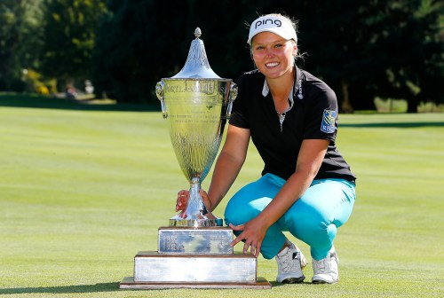PORTLAND, OR - AUGUST 16: Brooke Henderson of Canada poses with the trophy after her 21 strokes under par victory during the final round of the LPGA Cambia Portland Classic at Columbia Edgewater Country Club on August 16, 2015 in Portland, Oregon. (Photo by Jonathan Ferrey/Getty Images)