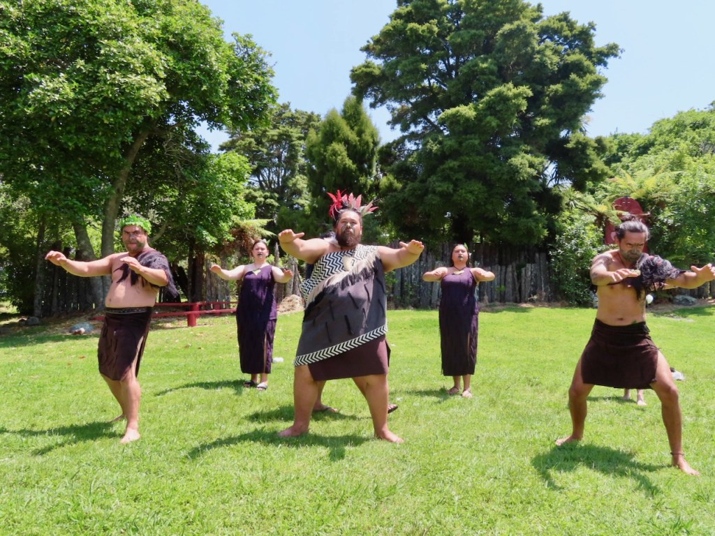 The Maori people performing a welcome dance.
