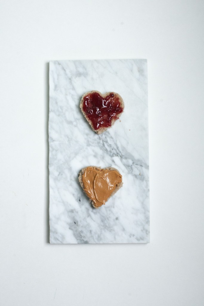 PB + J cut into hearts, part of a roundup of Valentine food ideas in heart shapes / Go Eat Your Bread with Joy #valentines