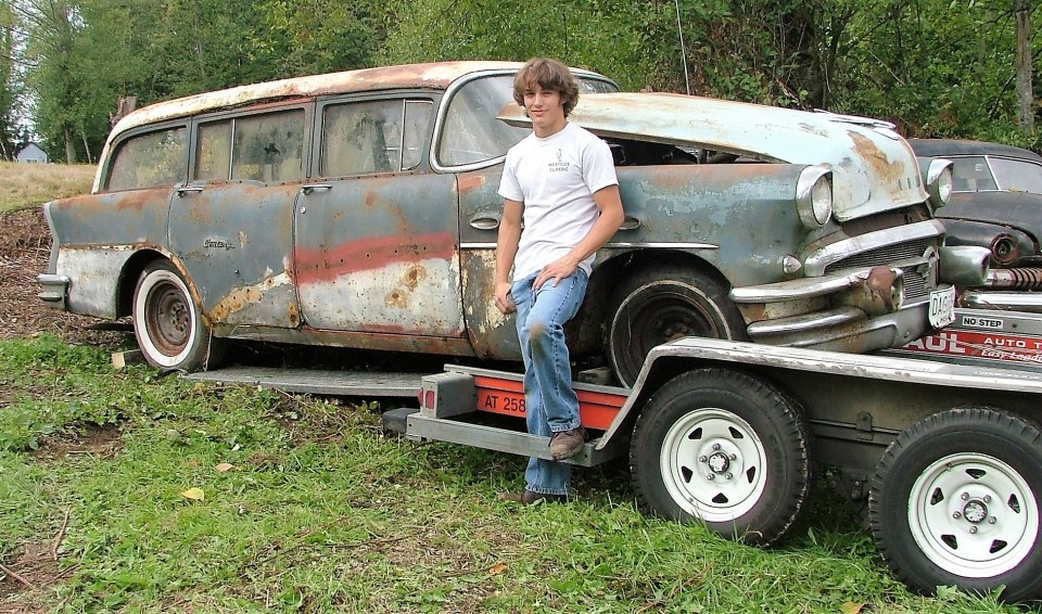 Ryland and the 1956 Buick Wagon at Goebel Hill Farm in 2009