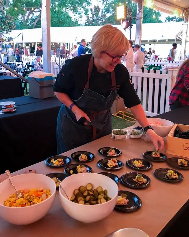 Photo recap why every Foodie Loves Cows N Cabs Event in Orlando. Chef Kathleen Blake of The Rusty Spoon.