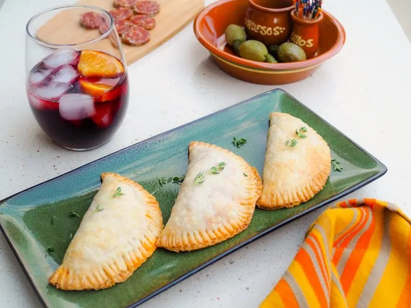 Easy Beef Empanada recipe from Cafe Tu Tu Tango you can make for Spanish Night at Home. This versatile recipe uses ingredients found in your pantry.