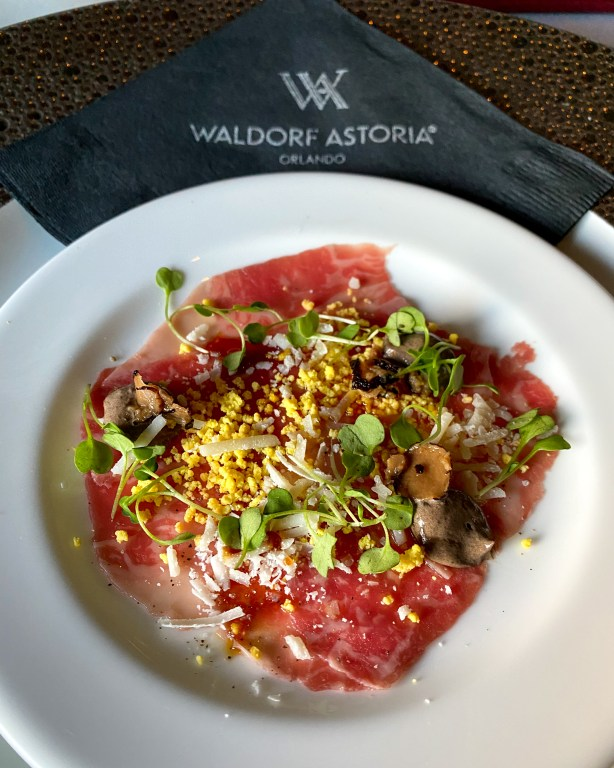 Best Orlando Resorts for epic foodie getaways includes Waldorf Astoria Orlando Bull & Bear