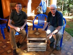 Isaiah and dad showing off the completed end table made from wooden crates