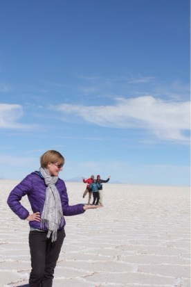 Allison Holding Isaiah, Eve & Marvin in the Palm of her Hand at Uyuni Salt Flats